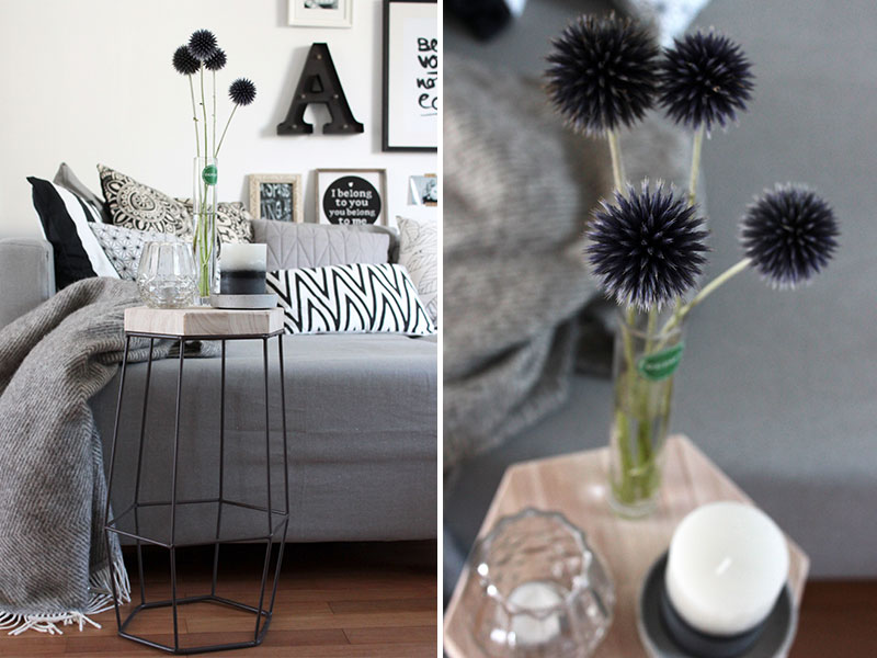 Beistelltisch-mit-Kerzen-und-Blumen-dekoriert