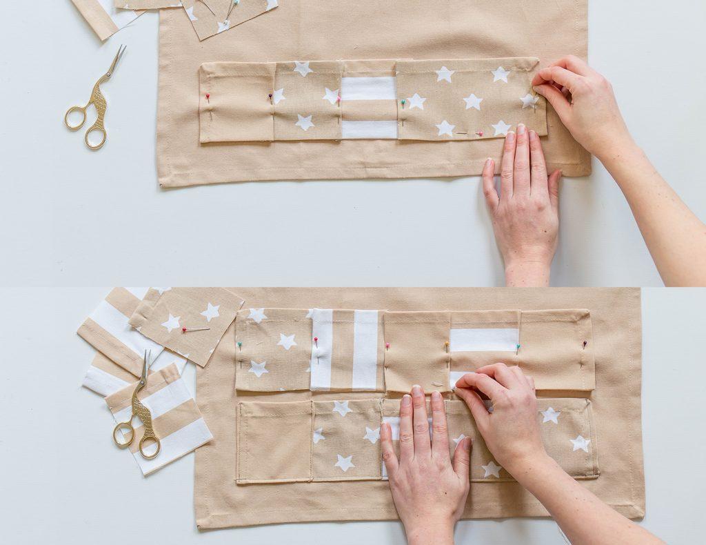 Mit Nadeln werden die Rechtecke auf dem großen Geschirrtuch festgesteckt und anschließend angenäht.